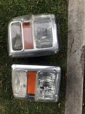 Selling a used set of Ford F250 F350 Super duty OEM headlights headlu for Sale in Palm Springs, CA