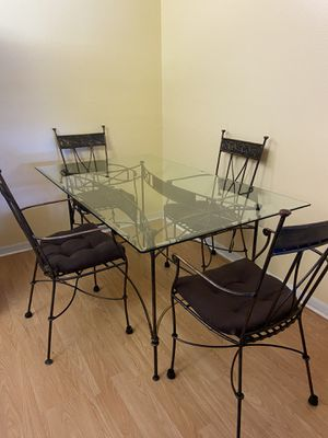 Glass top table with wrought iron base and chairs for Sale in New Port Richey, FL
