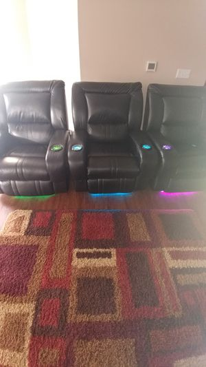Stadium seating with the ability to recline and have various lighting in the cup holders and beneath the chairs for Sale in US