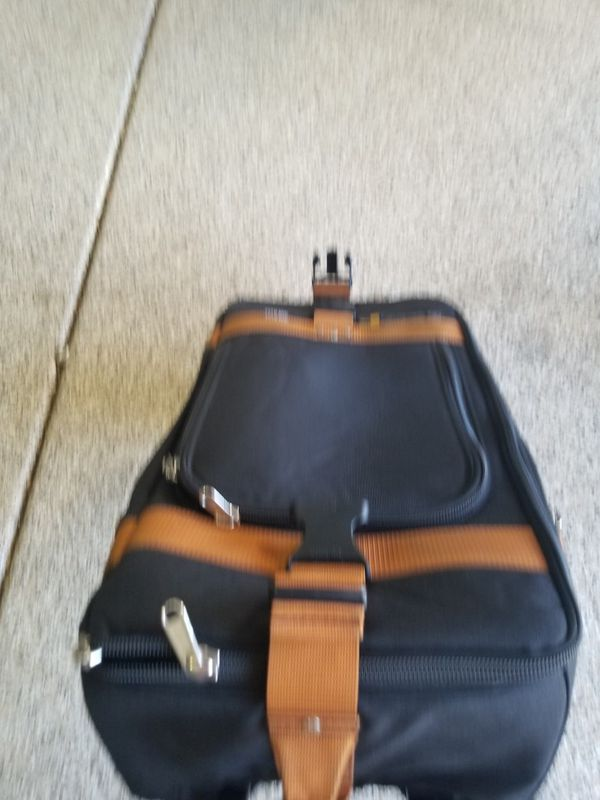 Small carry on club glove rolling duffle bag