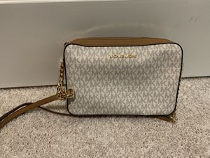 Authentic MK purse. Brown/tanish white cross body. Brand new and never used. Need gone ASAP. Make an offer for Sale in Baytown, TX