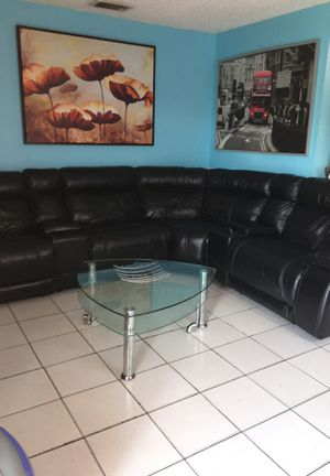 Black leather electric sofa sectional or devided for Sale in Miami, FL