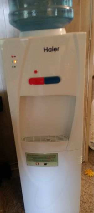 Water cooler floor stand .with hot water and mini storage .good working condition 110 volts for Sale in Port St. Lucie, FL