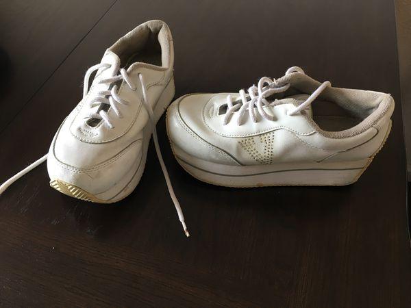 Pair of white vans low-top sneakers