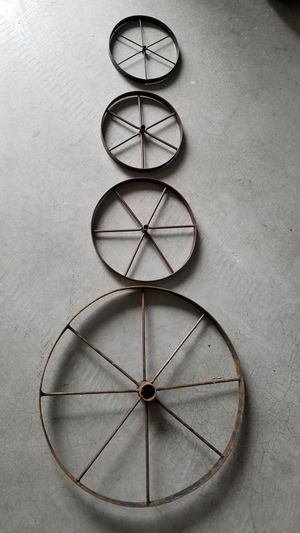 """Wagon wheels (16"""" $20 2 left) (9"""" $10 have 9) (7.5"""" $8 have 13) (6.5"""" $5 have 10) price is each. for Sale in Tacoma, WA"""