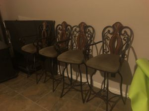 4 metal barstools made with wood. Bronze oil finish metal for Sale in Mesquite, TX