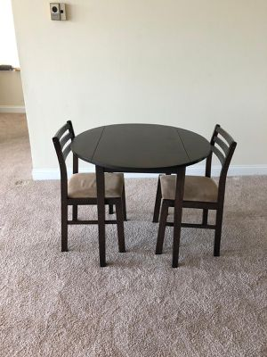 Table and 2 chairs ... brown for Sale in Alexandria, VA