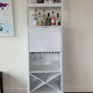 Wine Cabinet (25L x 76H x 13W) from Crate and Barrel for Sale in Seattle, WA