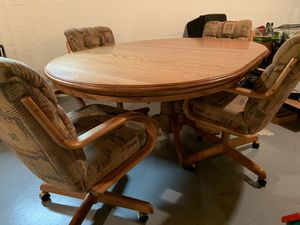 Amish solid oak kitchen table and four chairs with removable center leaf for Sale in Columbus, OH