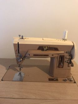 Original antique sewing machine. The cabinet converts to a desk. Very nice. Local pick up in Ballwin. for Sale in Ballwin,  MO