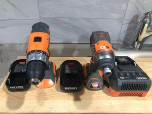 Ridgid hammer and impact drill drivers with 2 batteries. Charger and a case for Sale in Dearborn, MI