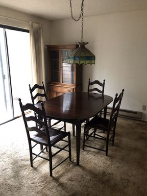 Distressed Mahogany dining room table with 4 matching rattan chairs. for Sale in Normandy Park, WA