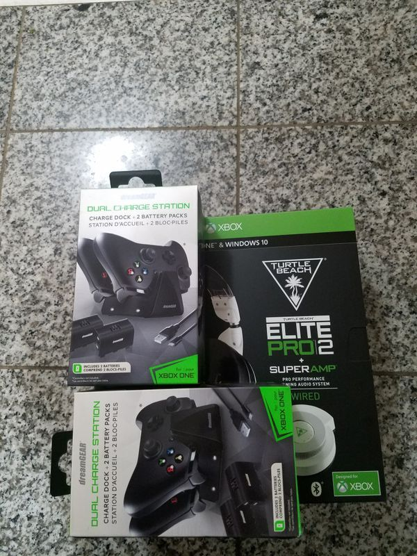 Turtle beach elite pro 2. Super amp head set plus 1 new game(assassins creed ) and 2 controller chargers .