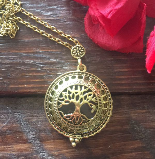 Tree of life locket necklace.