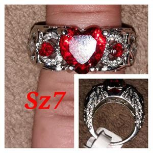 Beautiful sterling silver ring w/ large red lab Ruby heart. Angel wing design of sides. for Sale in Glen Burnie, MD