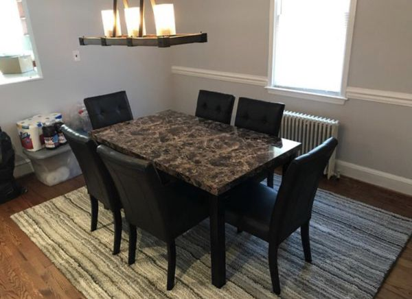 Brand new dining set; table and 6 leather chairs