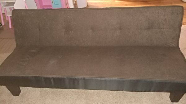 Brown futon in good conditions