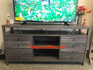 NEW IN THE BOX. JANE TV STAND UP TO 70IN TVS, DISTRESSED GREY FINISH, SKU# 161627-3TVS for Sale in Santa Ana, CA