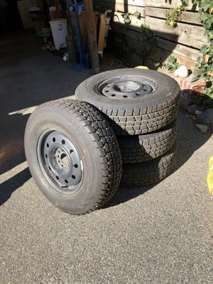 Snow Tires excellent condition on steel rims for Sale in Wenatchee, WA