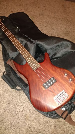 Ibanez Gio 4-string bass guitar with Guardian backpack Case, cord and a book for Sale in Merced, CA
