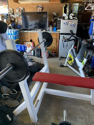 Commercial gym weight bench bigger faster stronger with Olympic bar& 2 35 bumper plates only. $300 firm for Sale in Norwalk, CA
