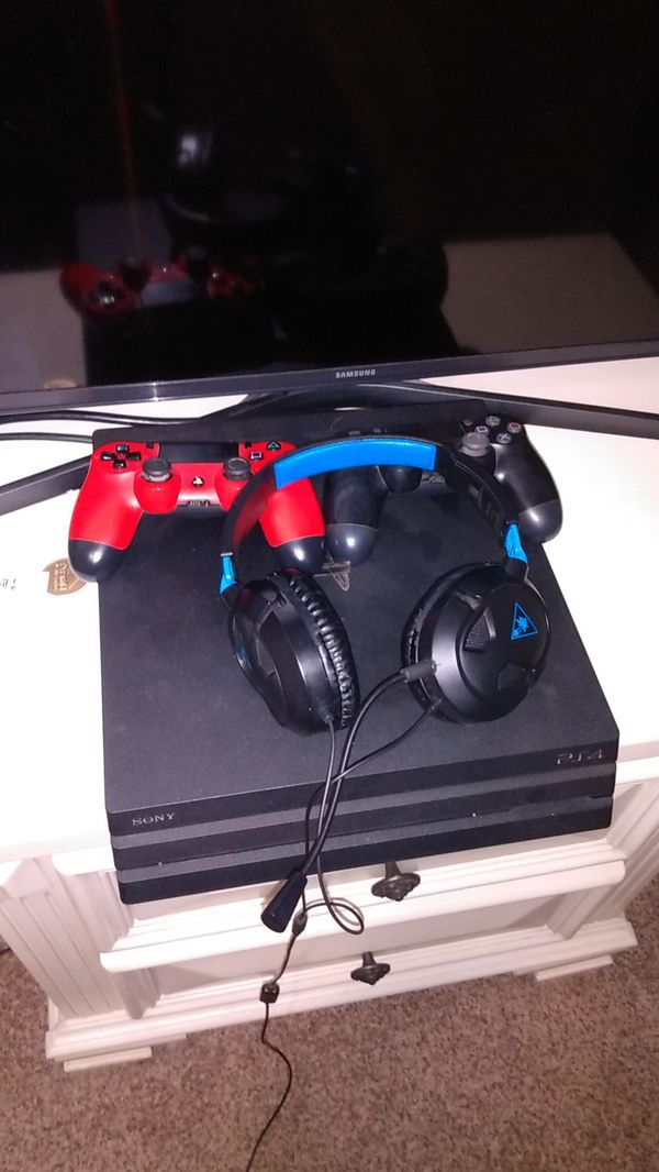 Ps4 Pro 1 tb. Comes with 2 controllers and a turtle beach headset