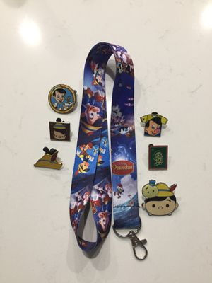 Disney Pinocchio lanyard with 6 tradable pins for Sale in Orlando, FL