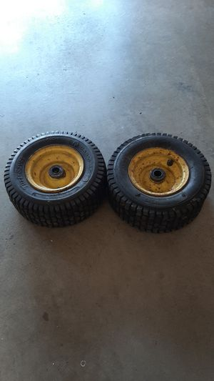 John Deere riding lawn mower front wheels and tires for Sale in Tacoma, WA