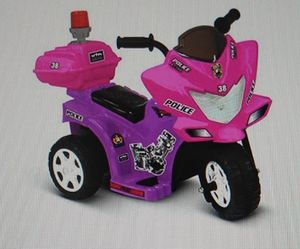 Ride on toys battery power lil patrol 6v battery powered motorcycle by Kids Motorz pink and purple for Sale in Twin Falls, ID