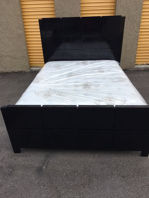 Black wood bed frame with brand new Queen size Stearns & Fosters luxury plush mattress and box spring in plastics for Sale in Tampa, FL