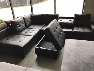 Black leather sectional with ottoman storage for Sale in Norcross,  GA