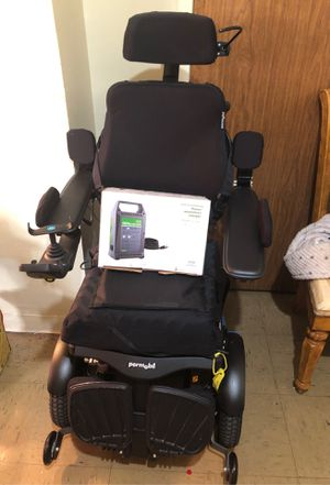 Permobil wheel chair and charger for Sale in Clinton, MD