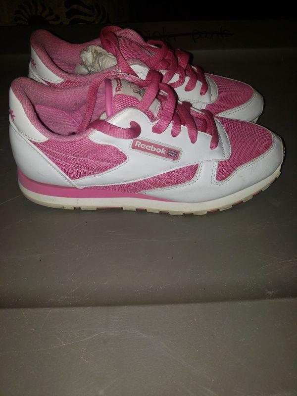 Pink and white Reebok classics.