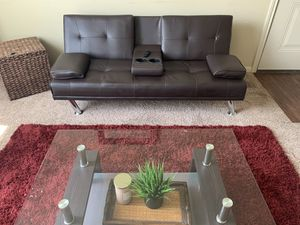 Brown leather futon- convertible couch in great condition. for Sale in Houston, TX