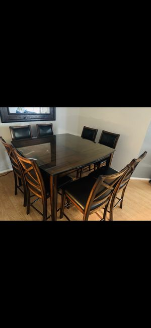 Dining table /8 chairs good condition with custom made thick glass top for Sale in Ontario, CA