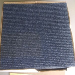 Brand new box of 20 quick stick back do it yourself carpet tile for Sale in Fitchburg, WI