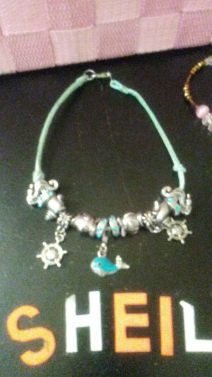 Leather suede, ankle bracelet with 13 charms on it handmade very nice and different for Sale in St. Louis, MO