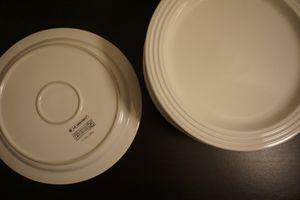 NEW Le creuset 11.25 inch dinnerware dinner plate set of 4 for Sale in Franconia, VA