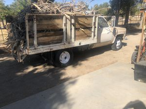 1982 Chevy Dually flatbed stake bed for Sale in Juniper Hills, CA