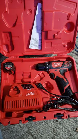 Milwaukee 12v drill in case with 2 batteries n charger plus an extra battery for Sale in BRUSHY FORK, WV