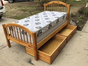 Twin Bed with Real Wood. Comes with frame, mattress, boxspring and 2 Large pullout Drawers. Excellent condition. Delivery available. Hablar espanol for Sale in Raleigh, NC