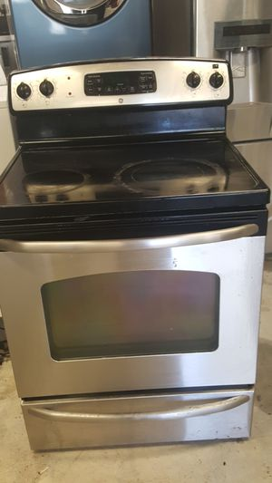GE Stainless steel smooth top electric stove digital clock self cleaning Works great for Sale in Nashville, TN