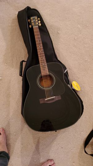 Black Yamaha guitar with case and a capo for Sale in McLean, VA