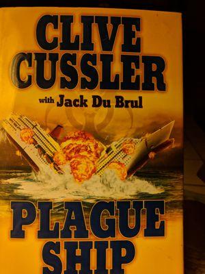 Clive Cussler trilogy hardback for Sale in Montgomery, AL