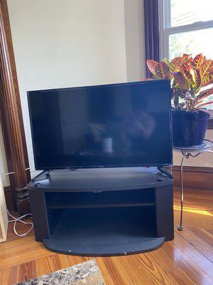 Black tv stand/ entertainment center for Sale in Boston, MA