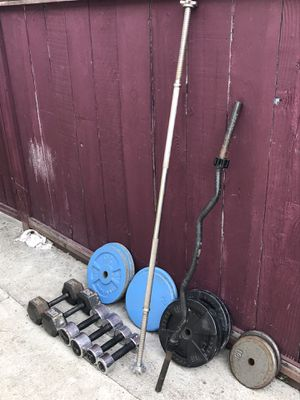 Standard straight bar, standard curl bar, and plates!! All 1in. Plus dumbells for Sale in Hayward, CA