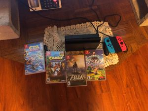 Nintendo switch v2 w/ sd card and games for Sale in Pasadena, CA