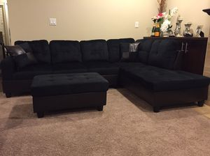 Midnight black microfiber sectional couch and ottoman for Sale in Everett, WA