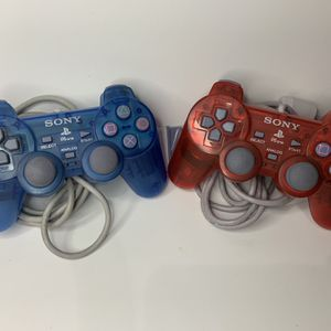 Red And Blue PS1 Or PS2 Controllers for Sale in Phoenix, AZ