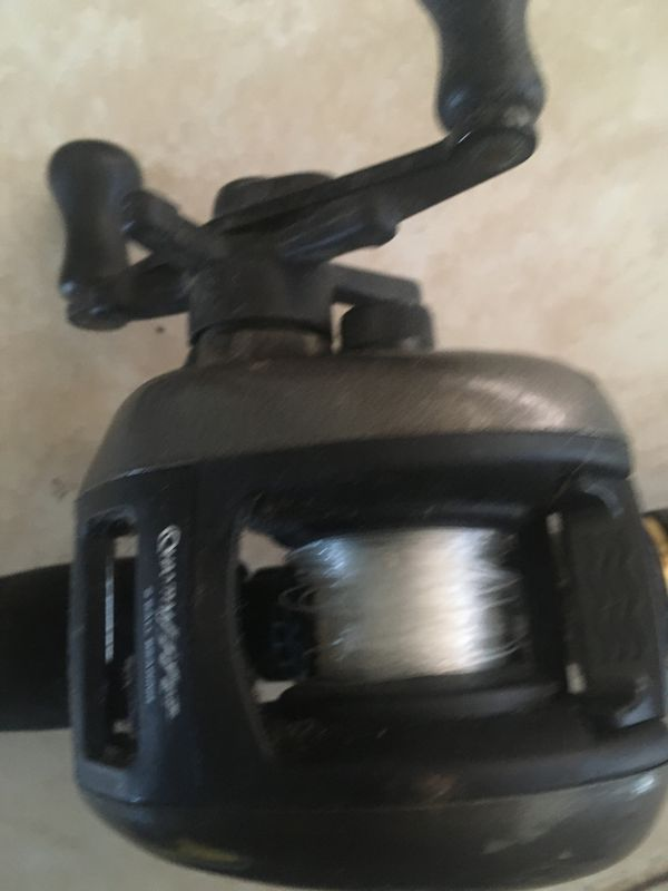 Three fishing rods and reels